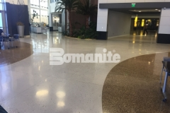 Bomanite Modena Monolithic was installed here in a soft gray tone and the black and blue natural aggregates and blue recycled glass that were beautifully exposed during the grinding and polishing process add distinctive detail to this low maintenance decorative concrete flooring.