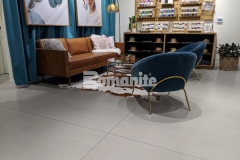 Bomanite Modena SL was utilized here to create a custom polished concrete overlay and this low maintenance surface adds a beautiful warm gray tone and satin finish that complement the interior design throughout the Nickel & Suede flagship store.