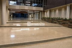 The Bomanite Renaissance Deep Grind System was utilized here with a custom mix of individually sourced aggregates, sands, and added integral color to create a custom polished concrete surface that will wear well and provide an eye-catching solid flooring surface.