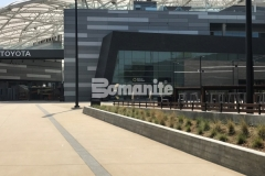 Bands of Bomanite Alloy decorative concrete with clear glass aggregates and reflective mirror flakes were incorporated into the Bomanite Sandscape Texture walkways at LAFC Stadium to serve as line formations that direct fans into the stadium while adding beautiful detail to the hardscape.