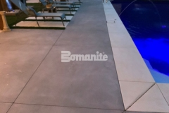 This durable decking surface was created using Bomanite Revealed decorative concrete in Antique White and Slate Gray with a scattering of mirror glass to add sparkle and sophistication to this elegant outdoor space.