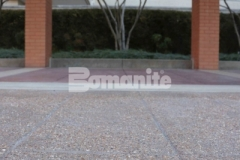 The Residence Condominiums entrance was updated by replacing the aging pavement with Bomanite Bomacron English Sidewalk Slate imprinted concrete and a Bomanite Sandscape Texture Exposed Aggregate finish – the perfect combination to create a hardscape surface that will not show wear from traffic or need constant resealing to look fresh.