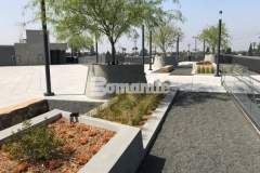 Bomanite Exposed Aggregate Sandscape Texture was used here to create a textured finish on these lineal planters and circular tree planters to complement the other design elements on this rooftop terrace and garden.