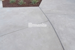 Sandscape Refined Antico by Bomanite was installed here to create a hardscape surface that showcases the architectural details in the decorative concrete for added texture and variation.