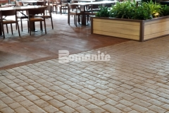 This stunning stamped concrete surface was created using the Bomanite Belgium Block imprint pattern, which was installed with meticulous placement precision and resulted in an intentionally consistent look that accentuates the natural, rustic environment at the Gaylord Rockies Resort & Convention Center.