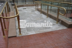 Bomanite Bomacron Medium Ashlar Slate was installed here to create a decorative concrete pedestrian bridge and wheelchair access ramps, adding durability and a unique design feature that perfectly complements the surrounding architecture.
