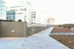 Bomanite Micro-Top ST was applied here as a decorative concrete overlay with a sand-finished surface to create planter walls and planter boxes and this beautiful finish is a perfect reflection of the urban lifestyle design at this mixed-use luxury condominium development.