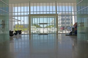 View of the front from the lobby of Cypress Waters Office Complex in Coppell, Texas, using Bomanite VitraFlor Custom Polishing Decorative Concrete flooring, installed by Texas Bomanite.