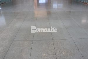 Long view of the lobby flooring using Bomanite VitraFlor Custom Polishing Decorative Concrete installed by Texas Bomanite in the lobby of the Cypress Waters Office Complex located in Coppell, Texas.