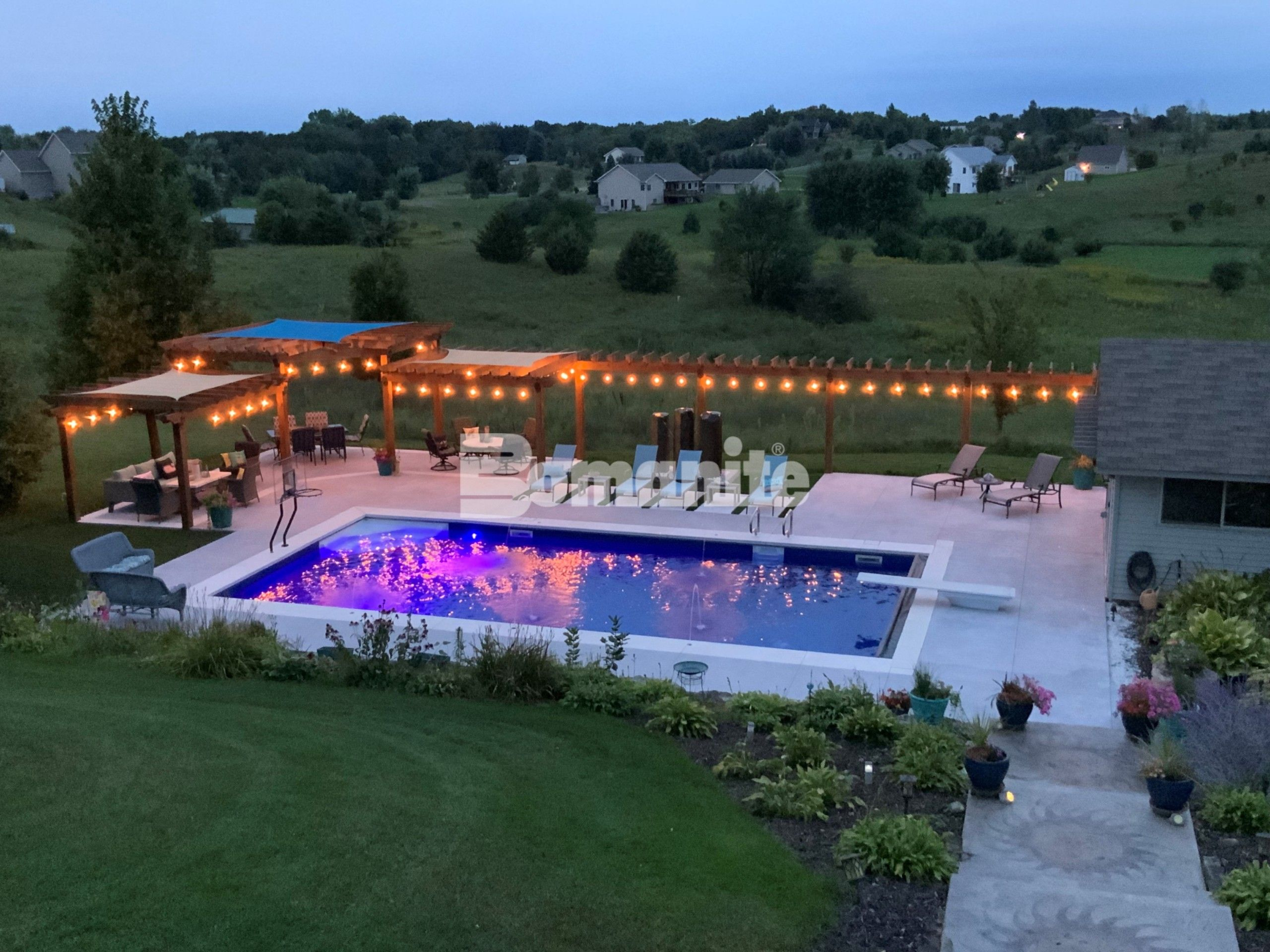 Concrete Arts, Inc. had the opportunity to create a stunning transformation for the homeowner's backyard renovation with the Bomanite Revealed Exposed Aggregate System supplying a slip-resistant, durable pool deck that caters to daytime relaxation and upscale evening gatherings.