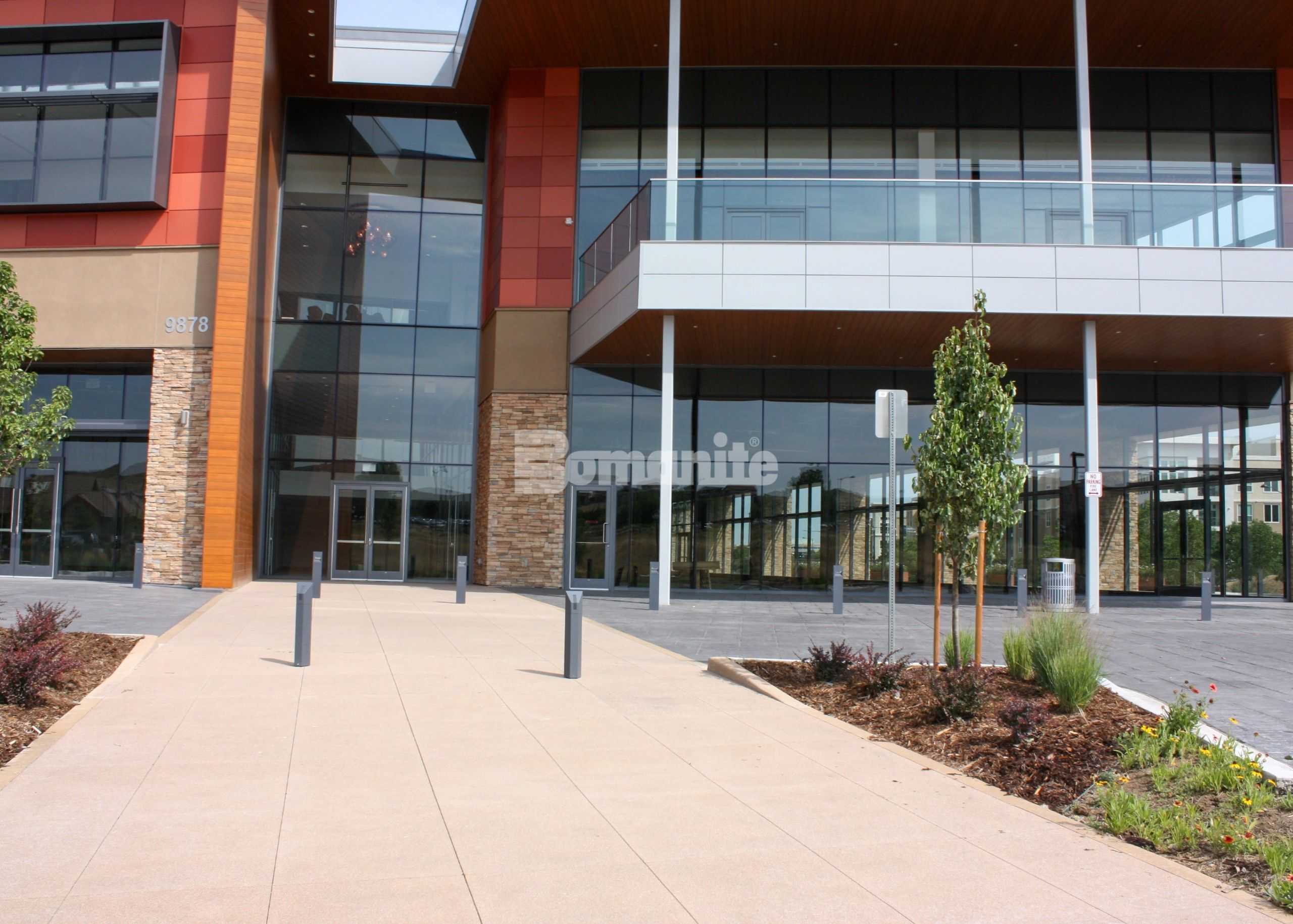 Colorado Hardscapes Installs Award Winning Bomanite Decorative Concrete Details for The Charles Schwab Conference Center at Ridgegate with Bomanite Imprint Systems in an English Sidewalk Slate Pattern for the Entry Way and surrounding drive areas.